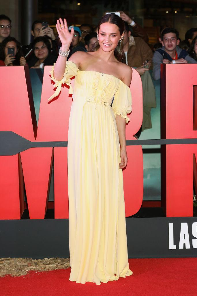 <p>On March 10th, the actress arrived in Mexico to promote her latest film. The 29-year-old graced the red carpet in, you guessed it, another gown by Louis Vuitton. She accessorised the sorbet-hued cold-shoulder number with glossy waves and minimal jewels. <em>[Photo: Getty]</em> </p>