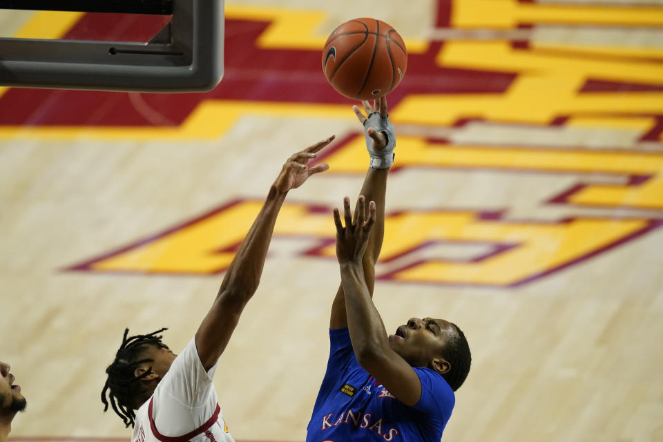 Kansas guard Bryce Thompson shoots over Iowa State forward Javan Johnson, left, during the first half of an NCAA college basketball game, Saturday, Feb. 13, 2021, in Ames, Iowa. (AP Photo/Charlie Neibergall)