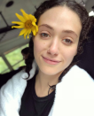 <p>The 31-year-old shares a post-rafting selfie, and we can't believe how angelic she looks. With her hair pulled back and adorned by a sunflower, she brings the focus to her big brown eyes. (Photo: Instagram/EmmyRossum) </p>