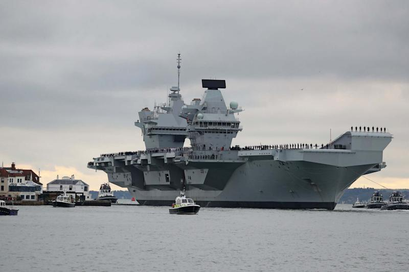 The aircraft carrier HMS Prince of Wales arrives at Portsmouth Naval Base: PA
