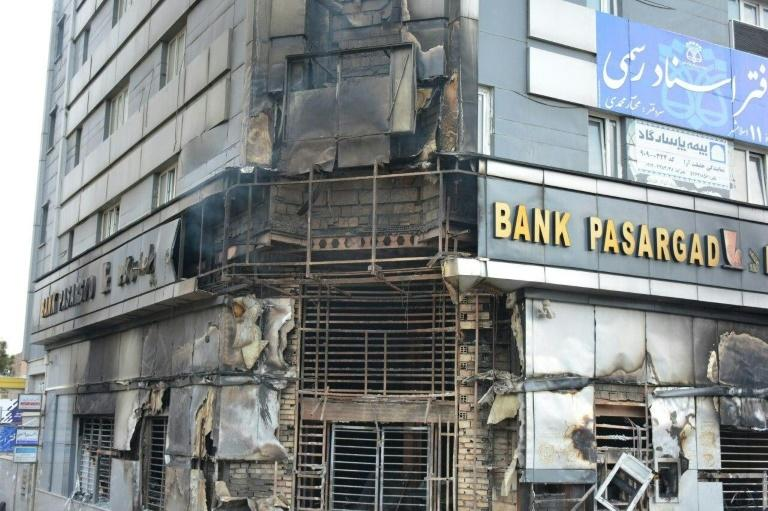 A scorched branch of the Pasargad bank, which was set ablaze by protesters, is seen in November 2019 in Eslamshahr, near the Iranian capital Tehran (AFP Photo/-)