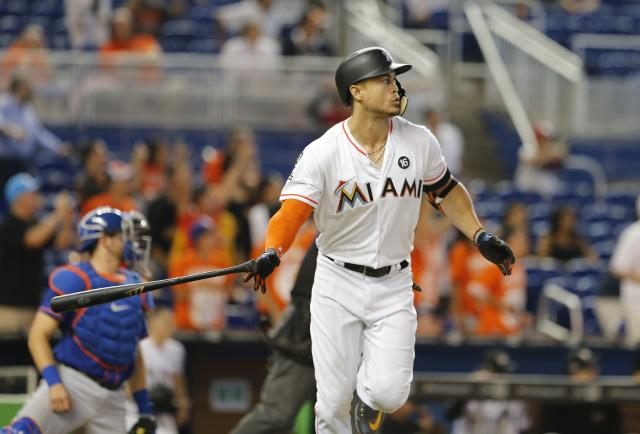 Giancarlo Stanton watches his 56th homer fly out of the park. (Getty Images)