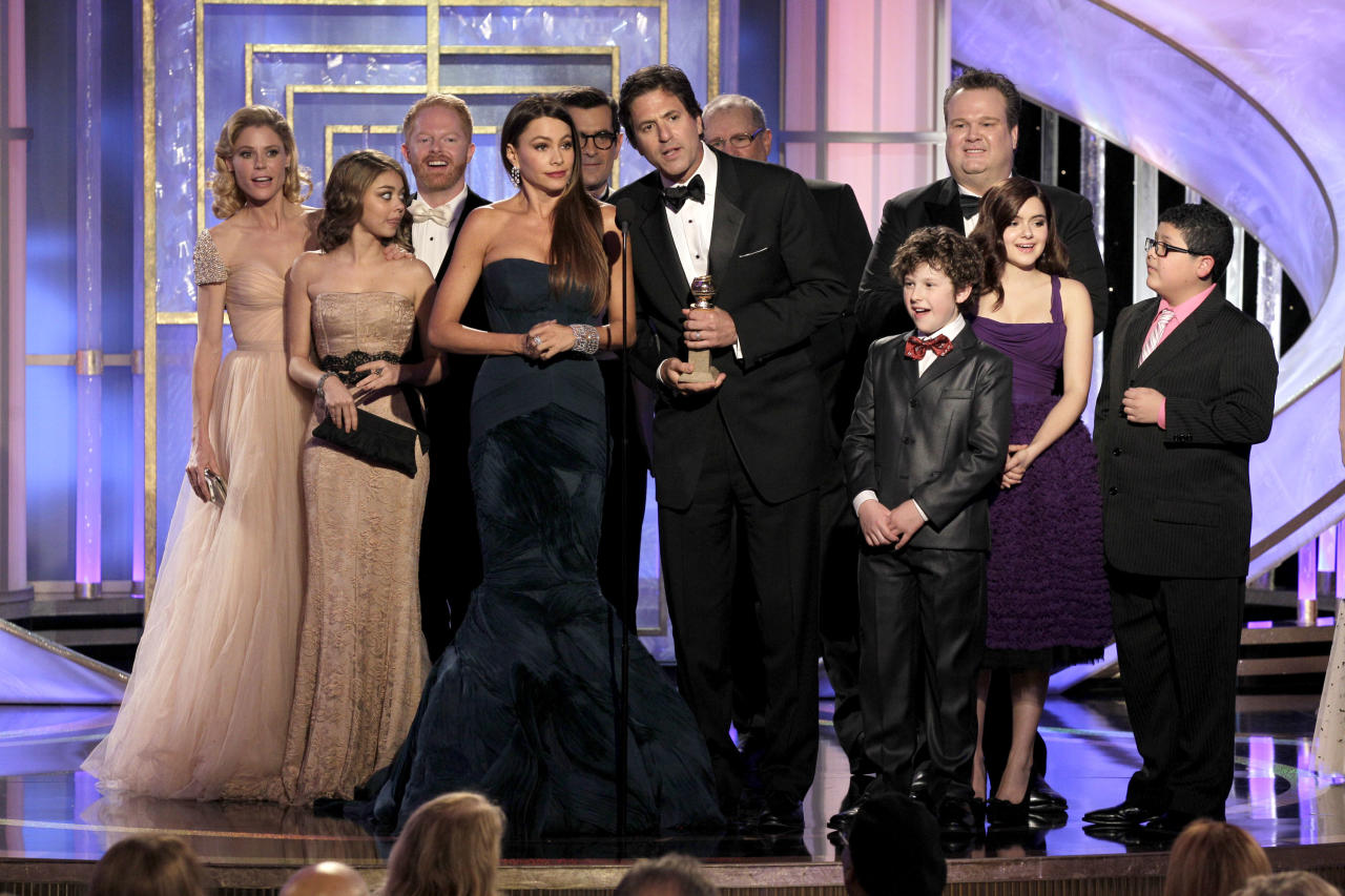 "BEVERLY HILLS, CA - JANUARY 15: In this handout photo provided by NBC, (L-R) Julie Bowen, Sarah Hyland, Jesse Tyler Ferguson, Sofía Vergara, Ty Burrell, creator/producer Steven Levitan, Ed O'Neill, Nolan Gould, Eric Stonestreet, Ariel Winter and Rico Rodriguez accept the Best Television Series - Musical or Comedy award for ""Modern Family""onstage during the 69th Annual Golden Globe Awards at the Beverly Hilton International Ballroom on January 15, 2012 in Beverly Hills, California. (Photo by Paul Drinkwater/NBC via Getty Images)"