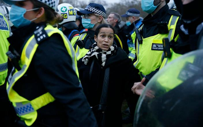 "A woman is arrested by Met Police during a ""World Wide Rally For Freedom"" protest in London - Getty"