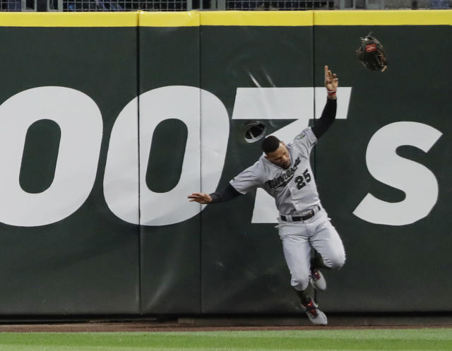 Minnesota Twins center fielder Byron Buxton crashes into the wall while trying to catch a two-run home run hit by Seattle Mariners' Nelson Cruz during the sixth inning of a baseball game Saturday, May 26, 2018, in Seattle. Buxton left the game after the play. (AP Photo/Ted S. Warren)