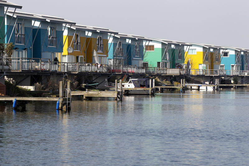In this photo taken Wednesday, March 28, 2012 amphibious homes are seen on the River Maas in Maasbommel, Netherlands. The Netherlands, a third of which lies below sea level, has been managing water since the Middle Ages and has thus emerged as a pioneer in the field, exporting its expertise to Indonesia, China, Thailand, Dubai and the Republic of the Maldives, an Indian Ocean archipelago that with a maximum elevation of about 2 meters (8 feet) is the world's lowest country. (AP Photo/Bas Czerwinski)