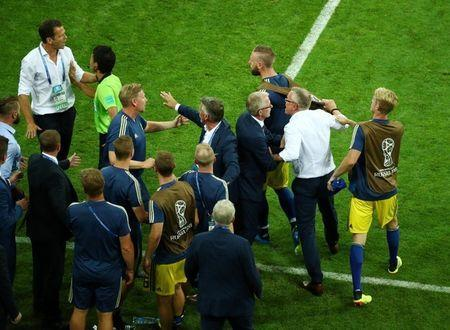 Soccer Football - World Cup - Group F - Germany vs Sweden - Fisht Stadium, Sochi, Russia - June 23, 2018 Sweden coach Janne Andersson and substitute players clash with Germany team manager Oliver Bierhoff after the match REUTERS/Hannah McKay