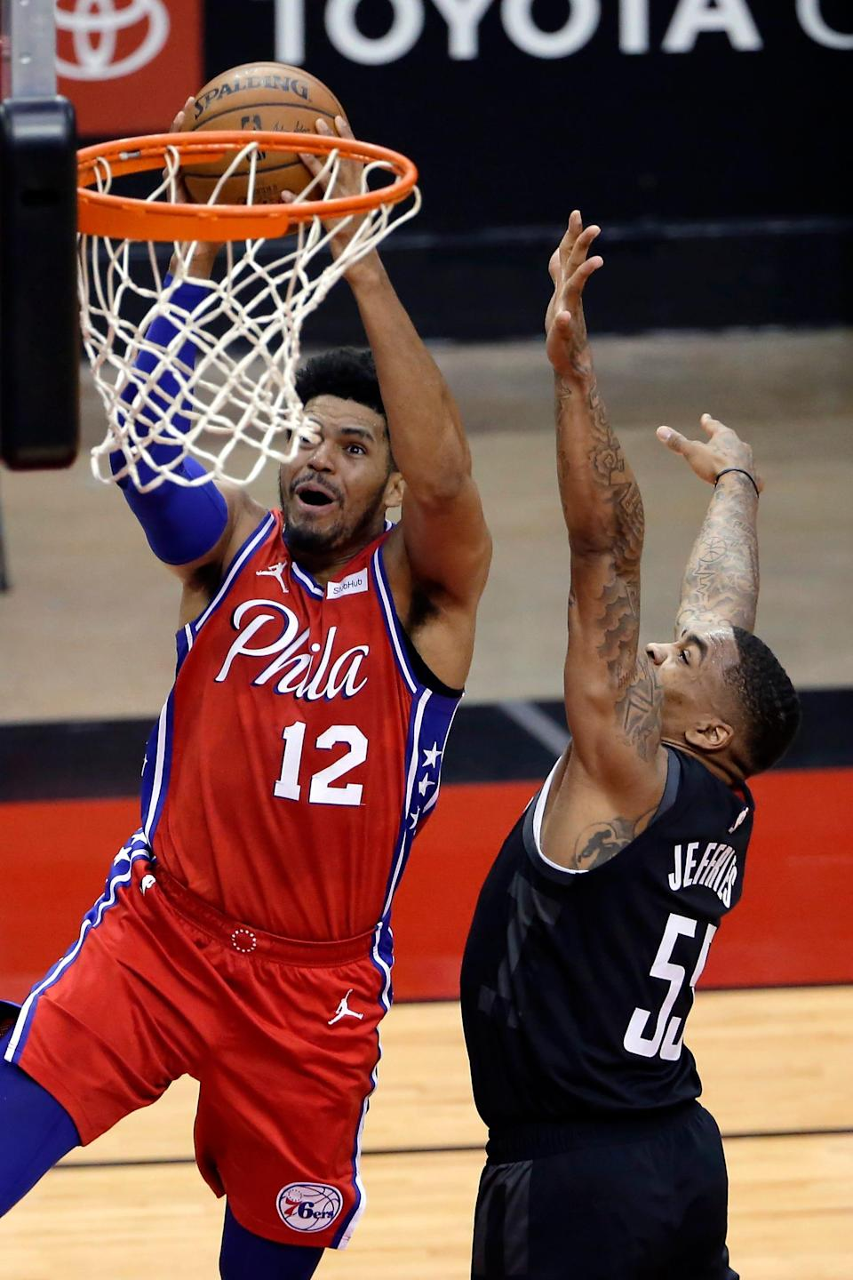Tobias Harris (12) scores over DaQuan Jeffries during the Sixers easy win over the Rockets on Wednesday.
