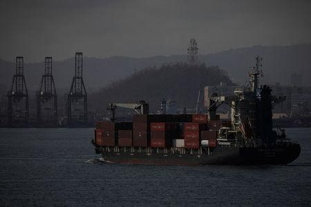 A cargo ship is seen in front of a port after the area was hit by Hurricane Maria in San Juan