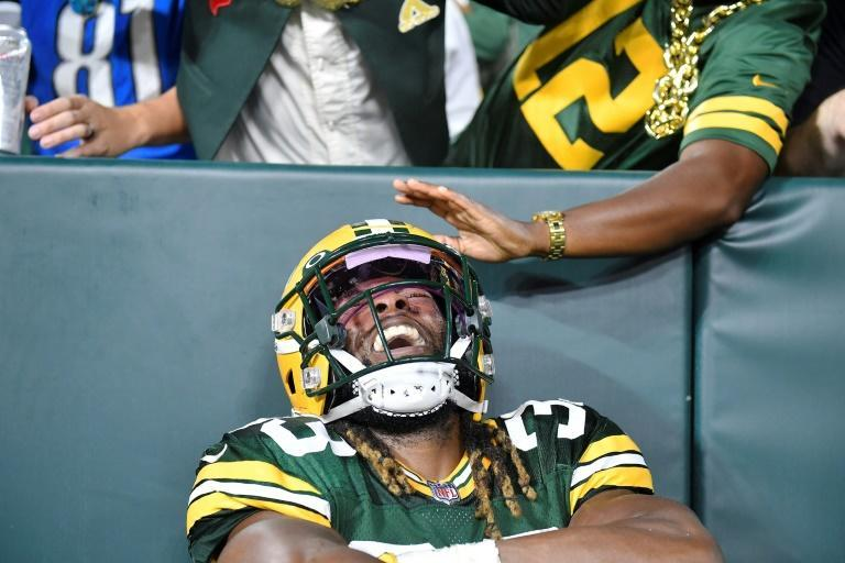 Green Bay Packers Aaron Jones shone in the first regular-season game with a packed house at Lambeau Field since the death of his father from Covid-19 (AFP/Quinn Harris)