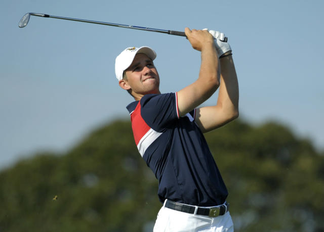 FILE - In this Sept. 8, 2013, file photo, Patrick Rodgers, of the United States team, tees off on the sixth hole during the second day of the Walker Cup golf tournament at National Golf Links of America in Southampton, N.Y. This week's Travelers Championship will feature the pro debuts of several of the top amateur players in the world, including Stanford teammates Patrick Rodgers and Cameron Wilson. (AP Photo/Kathy Kmonicek, File)