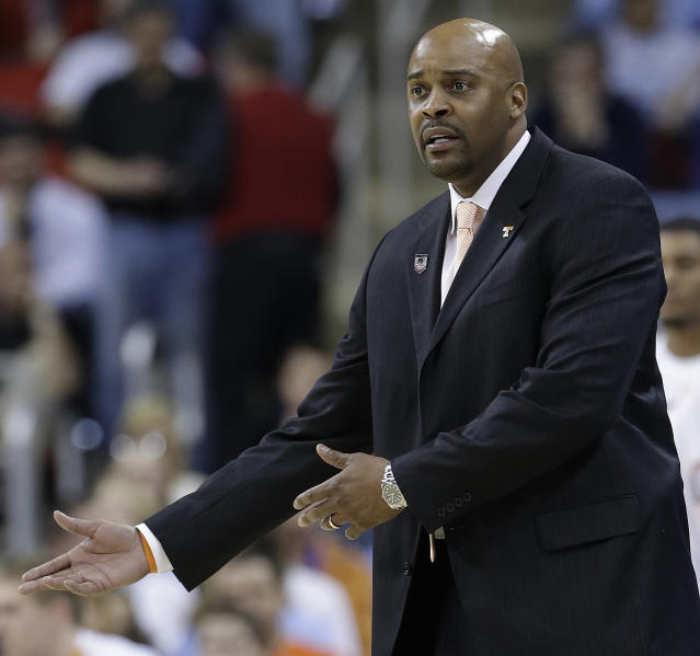 Tennessee head coach Cuonzo Martin speaks to players during the first half of an NCAA college basketball second-round tournament game against Massachusetts, Friday, March 21, 2014, in Raleigh, N.C. (AP Photo/Gerry Broome)