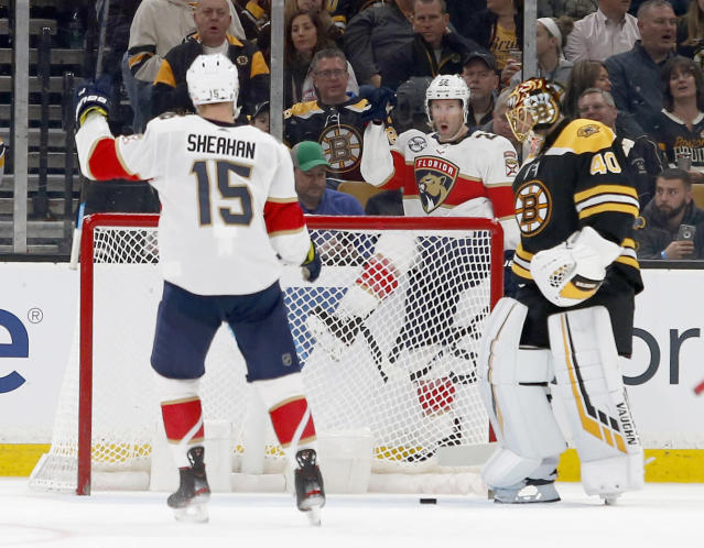Florida Panthers right wing Troy Brouwer (22) celebrates behind the goal towards teammate Riley Sheahan (15) after scoring past Boston Bruins goaltender Tuukka Rask (40) during the second period of an NHL hockey game, Saturday, March 30, 2019, in Boston. (AP Photo/Mary Schwalm)