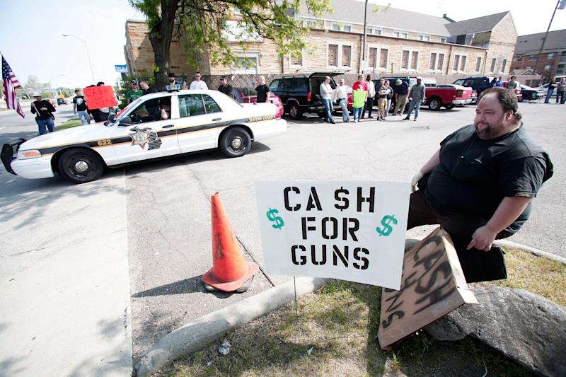 Citizens offering cash for guns in 2013 in Detroit.