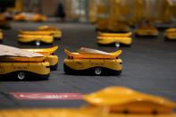 Robots transport parcels at the Hellenic Post's sorting centre in Kryoneri