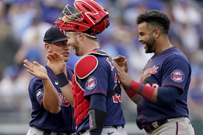 Minnesota Twins players celebrate after their baseball game against the Kansas City Royals Saturday, June 5, 2021, in Kansas City, Mo. The Twins won 5-4. (AP Photo/Charlie Riedel)