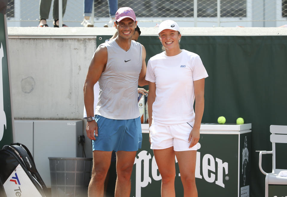 Rafael Nadal (pictured left) and Iga Swiatek (pictured right) take a photo after a 20 minute practice session on Court 5 ahead of the French Open 2021.