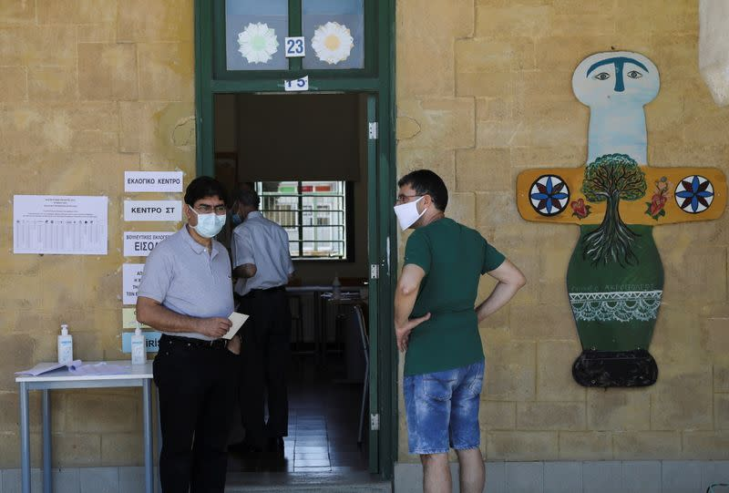 People wait to cast their vote during parliamentary elections at a polling station in Nicosia