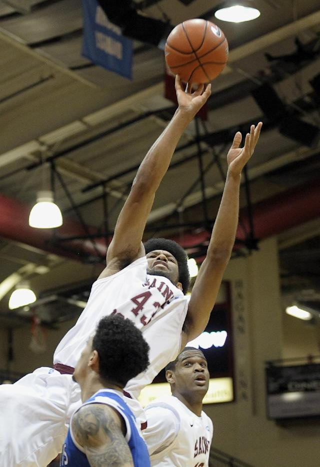 Saint Joseph's DeAndre' Bembry (43) takes a shot over Saint Louis' Austin McBroom during the first half of an NCAA college basketball game Wednesday, Feb. 5, 2014, in Philadelphia. (AP Photo/Michael Perez)