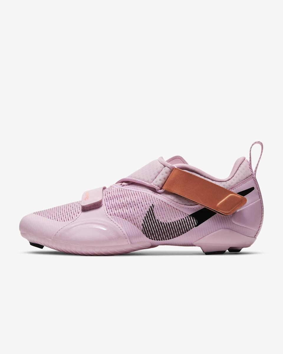"""<p><strong>Nike</strong></p><p>Nike.com</p><p><strong>$120.00</strong></p><p><a href=""""https://go.skimresources.com?id=74968X1525078&xs=1&url=https%3A%2F%2Fwww.nike.com%2Ft%2Fsuperrep-cycle-womens-indoor-cycling-shoe-tMMfR6%2FCJ0775-686"""" rel=""""nofollow noopener"""" target=""""_blank"""" data-ylk=""""slk:Shop Now"""" class=""""link rapid-noclick-resp"""">Shop Now</a></p><p>We love the sleek aesthetic design on this cycling shoe from Nike that functions well too. <strong>It features adjustable velcro straps up top to keep the shoe in place and also has rubber-tipped studs</strong> built into the bottom plate to give you traction when you're walking to and from your bike. Reviewers find the shoe lightweight and breathable too.</p><p><em>Compatible with</em><em> two-hole or three-hole cleat systems.</em></p>"""
