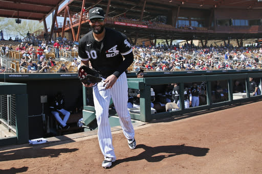 FILE - In this Monday, March 9, 2020 file photo, Chicago White Sox's Nomar Mazara heads out of the dugout for a spring training baseball game against the Cincinnati Reds in Glendale, Ariz. The Chicago White Sox declined to offer 2021 contracts to right fielder Nomar Mazara and pitcher Carlos Rodn on Wednesday, Dec. 2, 2020, sending the pair into free agency.(AP Photo/Sue Ogrocki, File)