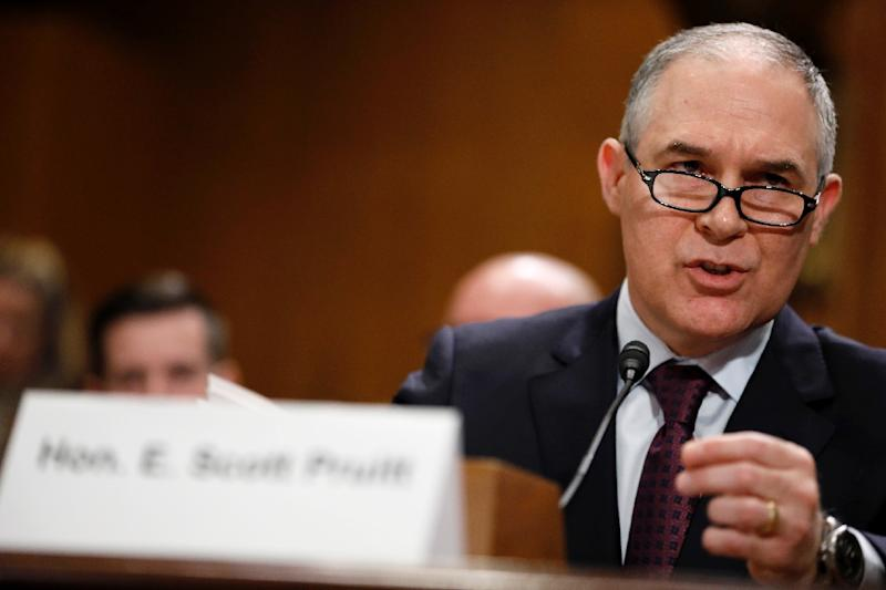 Then-Oklahoma Attorney General Scott Pruitt, President Donald Trump's choice to head the Environmental Protection Agency, testifies during his confirmation hearing before the Senate Committee on Environment and Public Works January 18, 2017 (AFP Photo/Aaron P. Bernstein)