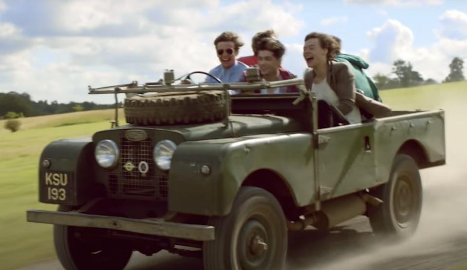 """Louis Tomlinson driving in the """"Live While We're Young"""" video."""