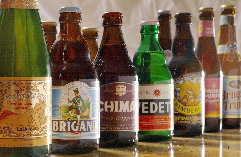 File - In this March 10, 2004 file photo, a selection, out of more than 450 types, of beer is shown in Brussels, Belgium. France, the land of wine, is planning heavy taxes on beer, and that is not going down well with brewers, even in other nations. President Francois Hollande is pushing through legislation to increase taxes on beer by 160 percent to help fund struggling social programs as France tries to contain a budget deficit hit hard by the economic crisis. The tax would affect local brews and the 30 percent of imported beer the French drink. (AP Photo/Geert Vanden Wijngaert, File)