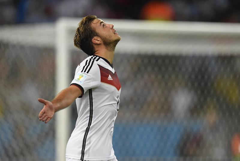 Germany's forward Mario Goetze celebrates after scoring during extra time of the 2014 FIFA World Cup final football match between Germany and Argentina at the Maracana Stadium in Rio de Janeiro on July 13, 2014