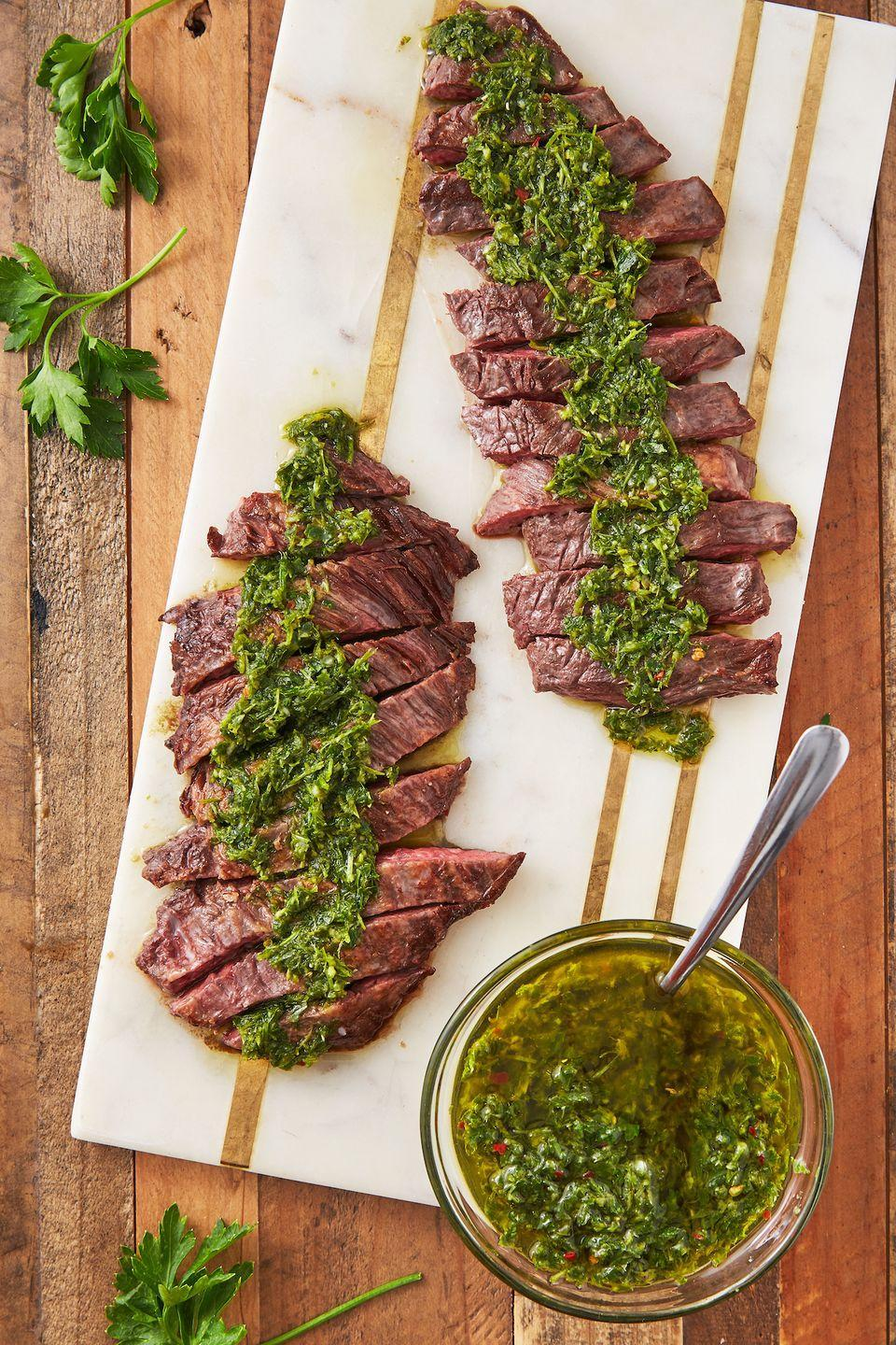 """<p>Our chimichurri sauce is good on <em>everything</em>, but especially a flank steak. </p><p>Get the recipe from <a href=""""https://www.delish.com/cooking/recipe-ideas/a27793321/chimichurri-sauce-recipe/"""" rel=""""nofollow noopener"""" target=""""_blank"""" data-ylk=""""slk:Delish"""" class=""""link rapid-noclick-resp"""">Delish</a>. </p>"""