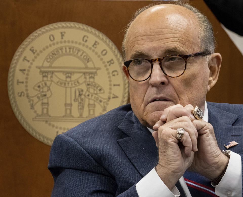 Rudi Giuliani listens to testimony during a subcommittee of the state Senate judiciary committee meeting at the State Capitol in Atlanta on Thursday, Dec. 3, 2020. Giuliani brought fellow lawyers and witnesses who alleged serious voting problems in Georgia and asked that the State Legislature chose Georgia's electors. (Ben Gray/Atlanta Journal-Constitution via AP)