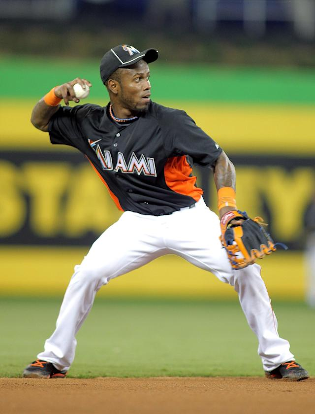 MIAMI, FL - APRIL 13: Shortstop Jose Reyes #7 of the Miami Marlins fields the ball against the Houston Astros at Marlins Park on April 13, 2012 in Miami, Florida. (Photo by Marc Serota/Getty Images)
