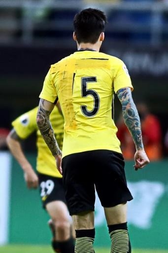 Five backroom staff were fined over the makeshift shirt