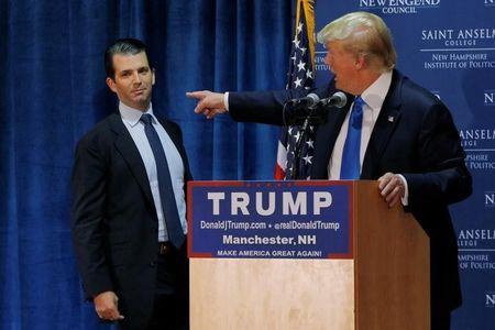 FILE PHOTO: Then U.S. Republican presidential candidate Donald Trump welcomes his son Don Jr. to the stage in Manchester