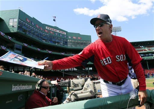 Boston Red Sox manager Bobby Valentine signs an autograph prior to the home opener of the Boston Red Sox against the Tampa Bay Rays in a baseball game at Fenway Park in Boston, Friday, April 13, 2012. (AP Photo/Elise Amendola)