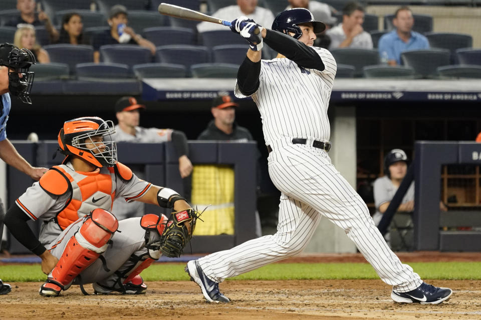 New York Yankees' Anthony Rizzo watches the ball after hitting a solo home run in the fourth inning of a baseball game against the Baltimore Orioles, Wednesday, Aug. 4, 2021, in New York. (AP Photo/Mary Altaffer)