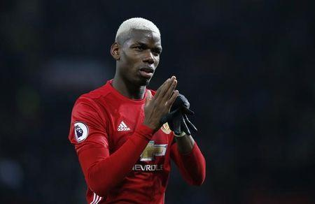 Manchester United's Paul Pogba applauds fans after the game