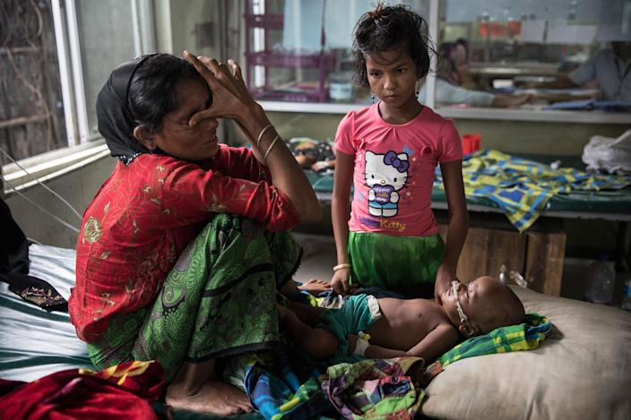 <p>Halima Khatu cries, worried about her son, Mohammed Harez, 8 months, suffering from acute pneumonia in the pediatric-neonatal unit at the 'Doctors Without Borders' Kutupalong clinic on October 3, 2017, in Cox's Bazar, Bangladesh. (Photograph by Paula Bronstein/Getty Images) </p>