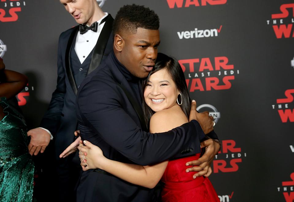 John Boyega (L) and Kelly Marie Tran at the world premiere of Star Wars: The Last Jedi on December 9, 2017. (Photo by Jesse Grant/Getty Images for Disney)