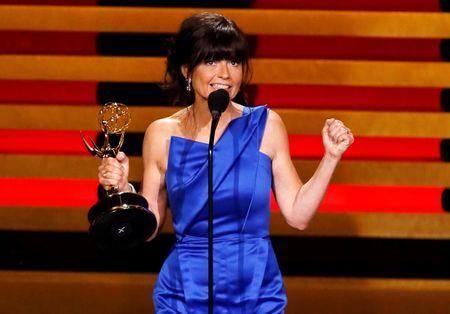 "Director Gail Mancuso accepts the award for Outstanding Directing For A Comedy Series for ""Modern Family"" during the 66th Primetime Emmy Awards in Los Angeles"
