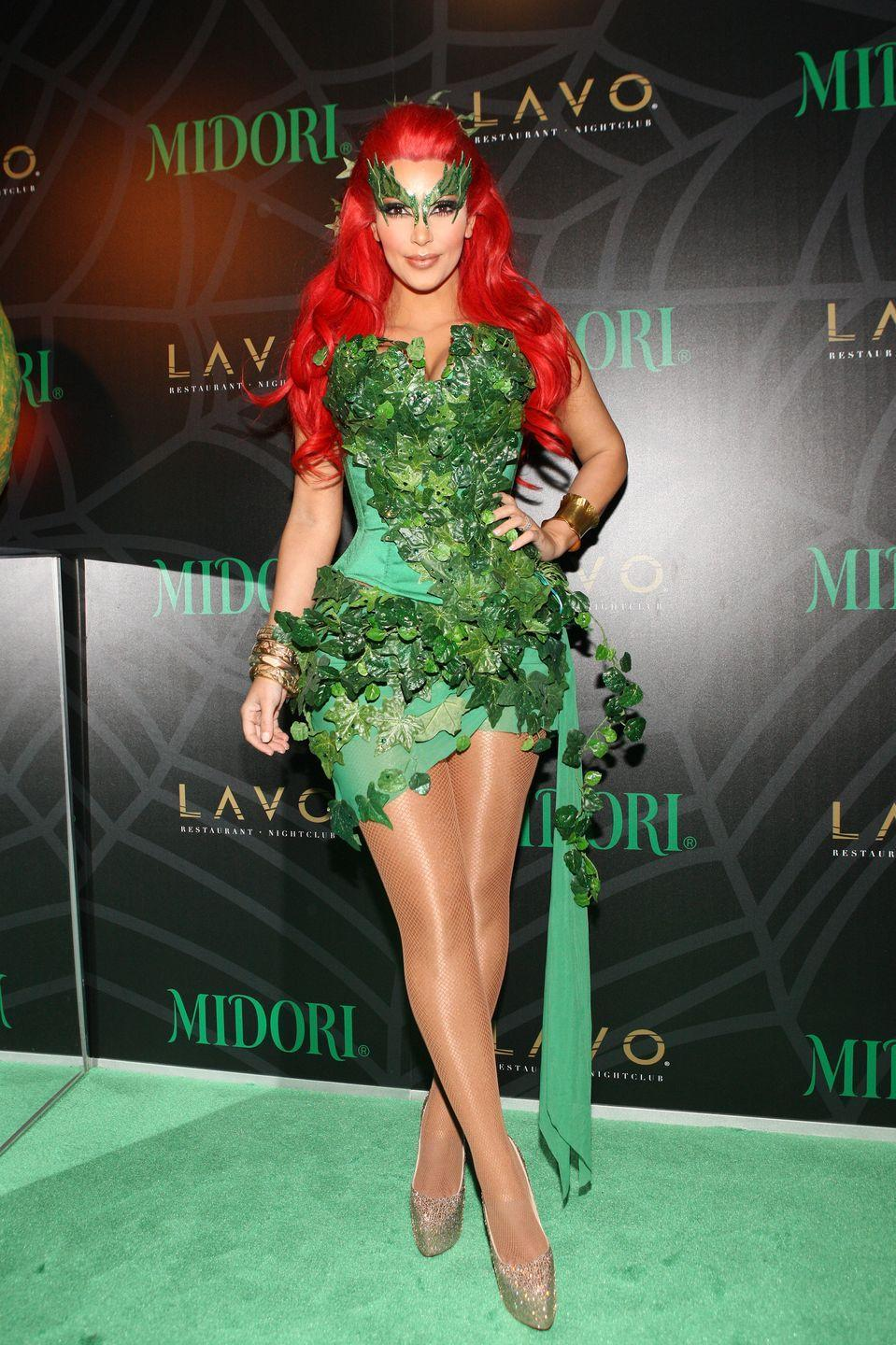 <p>TV personality Kim Kardashian stunned as the poisonous villain at the Midori Green Halloween costume party at New York City's Lavo in 2011.</p>