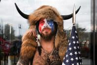 FILE PHOTO: Man poses with his face painted in the colors of the U.S. flag in Washington