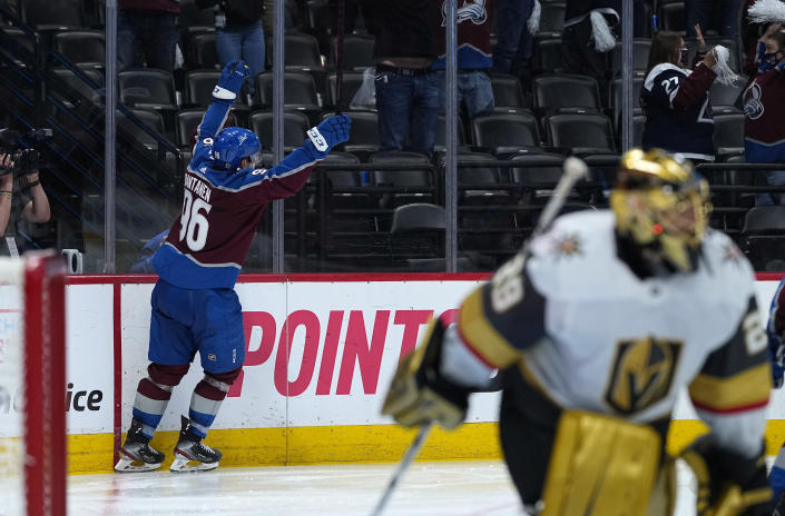 Colorado Avalanche right wing Mikko Rantanen (96) celebrates his overtime goal against Vegas Golden Knights goaltender Marc-Andre Fleury, foreground, in Game 2 of an NHL hockey Stanley Cup second-round playoff series Wednesday, June 2, 2021, in Denver. (AP Photo/Jack Dempsey)