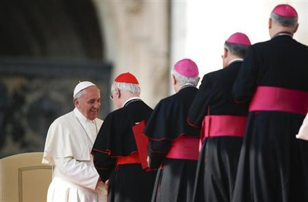 Pope Francis greet cardinals and bishops during the general audience in Saint Peter's Square at the Vatican