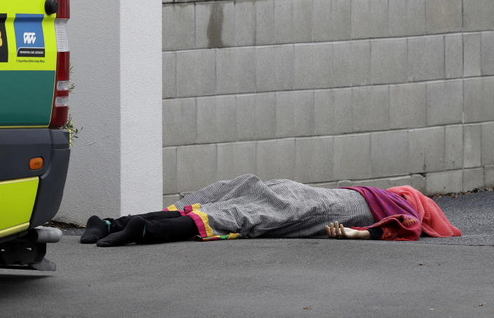 <p>A body lies on the footpath outside a mosque in central Christchurch, New Zealand. (AP Photo/Mark Baker) </p>