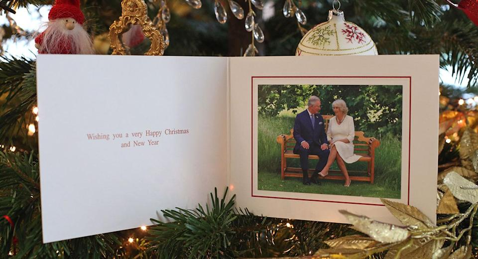 The 2018 Christmas card of the Prince of Wales and Duchess of Cornwall on a Christmas tree in Clarence House, London. The card features a photograph of the royal couple, taken by Hugo Burnand in the gardens of Clarence House. [Photo: PA]