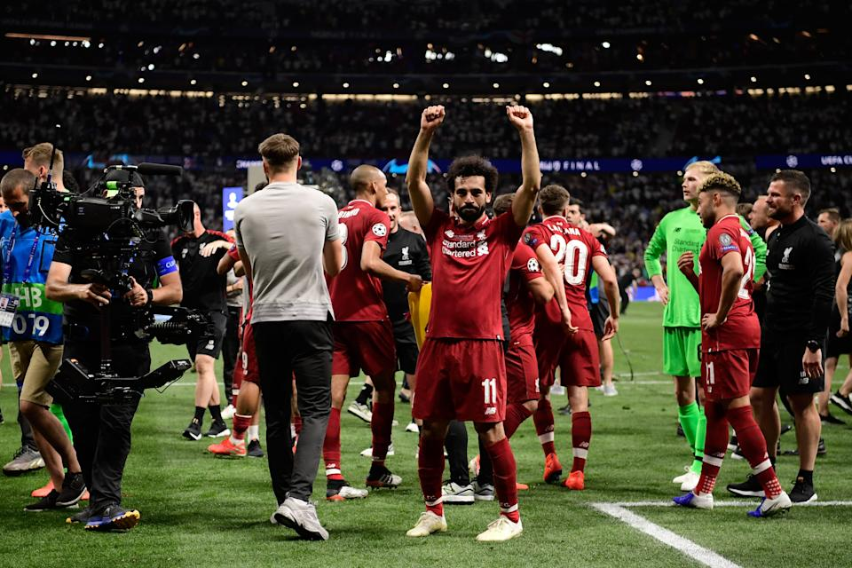 Liverpool's Egyptian midfielder Mohamed Salah celebrates after winning the UEFA Champions League final (Photo by JAVIER SORIANO / AFP)