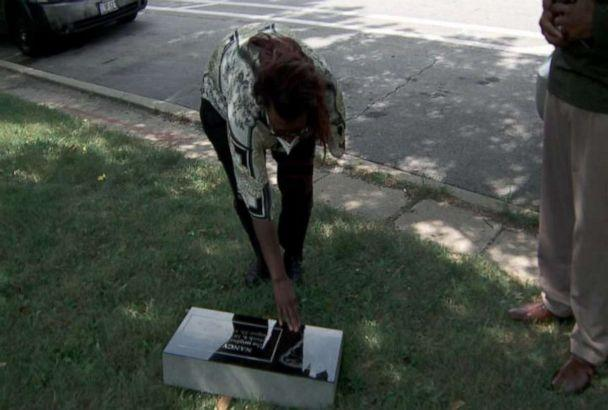 PHOTO: Sherry Williams gets a first look at headstone she has fought more than a decade to get made. (ABC News)