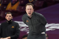 Minnesota head coach Richard Pitino directs his players in the second half of an NCAA college basketball game against Northwestern, Thursday, Feb. 25, 2021, in Minneapolis. (AP Photo/Jim Mone)