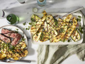 """<p>Grilled <a href=""""https://www.myrecipes.com/vegetable-recipes"""" rel=""""nofollow noopener"""" target=""""_blank"""" data-ylk=""""slk:vegetables"""" class=""""link rapid-noclick-resp"""">vegetables</a> are as essential a part of the outdoor, open-flame cooking experience as any cut of meat. And few vegetables say <i>summer</i> quite like zucchini and yellow summer squash. Dressed in olive oil and an abundance of fresh herbs, this versatile <a href=""""https://www.myrecipes.com/summer-grilling/sides/grilled-vegetable-recipes"""" rel=""""nofollow noopener"""" target=""""_blank"""" data-ylk=""""slk:grilled vegetable"""" class=""""link rapid-noclick-resp"""">grilled vegetable</a> recipe is perfect for just about any occasion.</p>"""